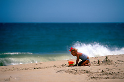 An unidentified toddler plays in the sand, Monday, Aug. 19, 2019 at Henlopen Acres Beach Club in Rehoboth Beach, Del. (Photo by D. Ross Cameron)