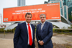 © Licensed to London News Pictures. 09/06/2016. London, UK. Former Executive Director of the Grassroots Out ALEX DEANE and Top City investor and Crystal Palace FC co-owner JEREMY HOSKING unveil their new EU referendum campaign 'Brexit Express' at Vauxhall Cross with the first of a series of billboard advertisements to be launched across major sites across the country on 9 June 2016. Photo credit: Tolga Akmen/LNP
