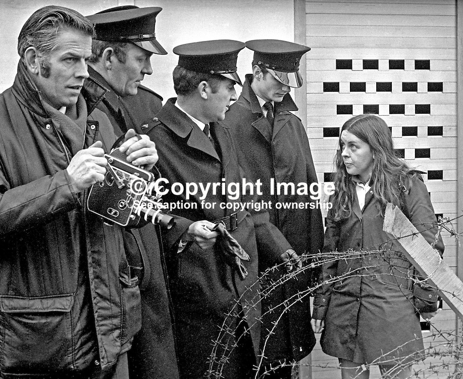 Civil rights activist & Independent MP for Mid-Ulster Bernadette Devlin in discussion with police halting the planned Dungannon Civil Resistance Committee march to Coalisland on 23rd January 1972. The police were enforcing a ban on marches imposed by Ulster Unionist Prime Minister Brian Faulkner on 18 January 1972. 197201230027b<br /> <br /> Copyright Image from Victor Patterson, Belfast, UK<br /> <br /> t: +44 28 9066 1296 (from Rep of Ireland 048 9066 1296)<br /> m: +44 7802 353836<br /> e: victorpattersonbelfast@gmail.com<br /> <br /> www.images4media.com<br /> <br /> Please see my full Terms and Conditions of Use at https://www.images4media.com/p/terms-conditions - it is IMPORTANT that you familiarise yourself with them.<br /> <br /> Images used online incur an additional cost. This cost should be agreed in writing in advance. Online images must be visibly watermarked i.e. © Victor Patterson or that of the named photographer within the body of the image. The original metadata must not be deleted from images used online.<br /> <br /> This image is only available for the use of the download recipient i.e. television station, newspaper, magazine, book publisher, etc, and must not be passed on to a third party. It is also downloaded on condition that each and every usage is notified within 7 days to victorpattersonbelfast@gmail.com.<br /> <br /> The right of Victor Patterson (or the named photographer) to be identified as the author is asserted in accordance with The Copyright Designs And Patents Act (1988). All moral rights are asserted.