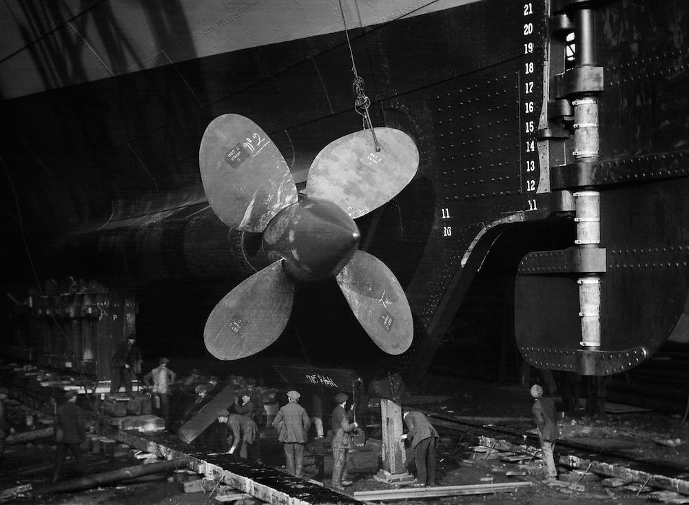 Workers Beneath Propeller, Swan Hunter & Wigham Richardson shipyard, England, 1928