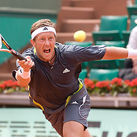 04 June 2007: Jonas Bjorkman of Sweden rushes to hit a forehand shot  to Carlos Moya of Spain during the French Tennis Open fourth round match won 7-6(5), 6-2, 7-5 by Carlos Moya over Jonas Bjorkman on day 9 at Roland Garros, in Paris, France.