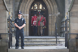 © Licensed to London News Pictures . 12/07/2013 . Bury , UK . An honour guard in front of the church which has guarded the building and the coffin outside , overnight . Security checks in Bury Town Centre ahead of the funeral . The funeral for Fusilier Lee Rigby at Bury Parish Church in Bury town centre today (Friday 12th July 2013) , watched by 100s of people . Fusilier Rigby's coffin was held in Bury Parish Church overnight , watched over by an honour guard of soldiers from the 2nd Battalion Royal Regiment of Fusiliers ( 2RRF ) . Rigby was brutally murdered in Woolwich , London on 22nd May 2013 . Photo credit : Joel Goodman/LNP