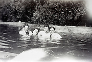 friends posing while in the water France