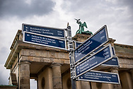 Berlin, Germany - September 3, 2015: Directions and distances to various landmarks within walking distance are posted at the Brandenburg Gate in Berlin, Germany.