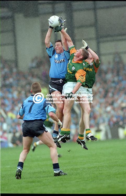 28-07-1996. Meath v Dublin - Leinster SFC Final at Croke Park.<br /> Paul Bealin, Dublin gains possession as Trevor Giles gets his fist to the ball.<br /> Photo: John Quirke / www.quirke.ie<br /> ©John Quirke Photography, 16 Proudstown Road, Navan. Co. Meath. (info@quirke.ie / 046-9028461 / 087-2579454).