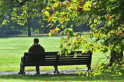 © Licensed to London News Pictures. 19/10/2018<br /> Greenwich, UK.<br /> A man sitting on a park bench enjoying the autumn weather.<br /> Autumnal sunny October weather today in Greenwich Park, Greenwich.<br /> Photo credit: Grant Falvey/LNP
