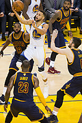 Golden State Warriors guard Stephen Curry (30) takes the ball to the basket against the Cleveland Cavaliers during Game 1 of the NBA Finals at Oracle Arena in Oakland, Calif., on June 1, 2017. (Stan Olszewski/Special to S.F. Examiner)