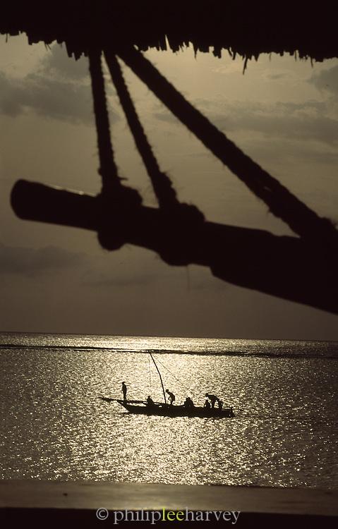 Fishermen on a traditional dhow boat in the water off the island of Zanzibar, a semi autonomous region of Tanzania