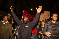 """London, November 26th 2014. A vigil for teenager Mike Brown who was shot dead by a policeman in Ferguson, Missouri this year, takes place outside the US embassy in London. Anti-racism and human rights campaigners called the 'emergency' protest following a court verdict that clears Police Officer Darren Wilson of murder. PICTURED: A protester makes the """"hands-up, don't shoot!"""" gesture as the march proceeds through Mayfair."""