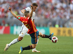 MOSCOW, July 1, 2018  Jordi Alba (bottom) of Spain vies with Roman Zobnin of Russia during the 2018 FIFA World Cup round of 16 match between Spain and Russia in Moscow, Russia, July 1, 2018. (Credit Image: © Xu Zijian/Xinhua via ZUMA Wire)