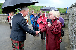 The Prince of Wales, known as the Duke of Rothesay while in Scotland, talks with Edna Anderson during a visit to Sail Loft Bunkhouse, Portsoy where he willl met members of the restoration team who have converted 18th century sailmakers' cottages into the 25-bed Sail Loft Bunkhouse.