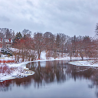 Massachusetts winter landscape photography of the beautiful Concord River curving its way through the Minute Man National Historical Park in Concord, Massachusetts. The building atop of the hill is the North Bridge Visitor Center. When I was photographing at this National Historic Park a bald eagle must have watched me carefully before deciding to mess with the photographer and catch me off guard. I grabbed the camera off the tripod, only to be able to take a blurry site view picture and capture his tail in a second photo when it flew away in the direction of this river view. I guess the majestic national emblem of the United States America threw me a stick for this landscape and river composition which I very much appreciated following an epic bird photography fail. <br /> <br /> Concord River landscape photography photos including the North Bridge Visitor Center are available as museum quality photo, canvas, acrylic, wood or metal prints. Wall art prints may be framed and matted to the individual liking and interior design decoration needs:<br /> <br /> https://juergen-roth.pixels.com/featured/north-bridge-visitor-center-and-concord-river-juergen-roth.html<br /> <br /> Good light and happy photo making!<br /> <br /> My best,<br /> <br /> Juergen