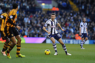 Gareth McAuley of West Brom in action. Barclays Premier league, West Bromwich Albion v Hull city at the Hawthorns in West Bromwich, England on Saturday 21st Dec 2013. pic by Andrew Orchard, Andrew Orchard sports photography.