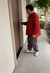 Homeowner locks the front door  as he leaves his now empty home for the last time in Vallejo, Calif. He lost his home in 2009 to foreclosure due to a combination of job loss, adjustable loan payments doubling and  home value under water nearly fifty percent. Photo by Kim Kulish