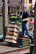 """A market vender offloads fresh fruit by boat. Venice (Venezia) is the capital of Italy's Veneto region, named for the ancient Veneti people from the 10th century BC. The romantic """"City of Canals"""" stretches across 117 small islands in the marshy Venetian Lagoon along the Adriatic Sea in northeast Italy, between the mouths of the Po (south) and Piave (north) Rivers. The Republic of Venice was a major maritime power during the Middle Ages and Renaissance, a staging area for the Crusades, and a major center of art and commerce (silk, grain and spice trade) from the 13th through 17th centuries. The wealthy legacy of Venice stands today in a rich architecture combining Gothic, Byzantine, and Arab styles. Composer Antonio Vivaldi (1678-1741) was born in Venice."""