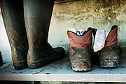 Scarpe utilizzate dai sikh durante il lavoro nei campi, Sabaudia (Latina), Giugno 2014.  Christian Mantuano / OneShot