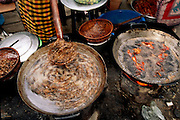 Phnom Penn, Cambodia. Central market. Fried crickets on the left, with small fried chickens on the right.