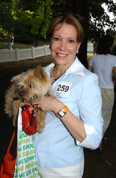 SYBIL KRETZMER and her dog at the Macmillan Cancer Support Dog Day held in the gardens of the Royal Hospital, Chelsea, London on 4th July 2006.<br /><br />NON EXCLUSIVE - WORLD RIGHTS