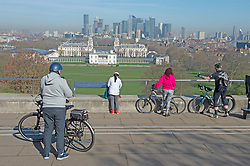 © Licensed to London News Pictures 30/03/2021. Greenwich, UK. Blue sky over London. People enjoying the hot sunny weather in Greenwich Park, London today as the rule of six allows friends and family to meet up during this third coronavirus lockdown. Photo credit:Grant Falvey/LNP