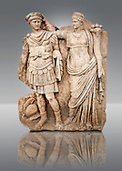 Photo of Roman releif sculpture of Aphrodite is crowned by Andreia from Aphrodisias, Turkey, Images of Roman art bas releifs. Buy as stock or photo art prints.  The drapped goddess figure is thought to be Aphrodite, whilst the female bare breasted warrior in amazonian dress is Roma or Andreia [ Bravery ].  Black .<br /> <br /> If you prefer to buy from our ALAMY STOCK LIBRARY page at https://www.alamy.com/portfolio/paul-williams-funkystock/greco-roman-sculptures.html . Type -    Aphrodisias     - into LOWER SEARCH WITHIN GALLERY box - Refine search by adding a subject, place, background colour, museum etc.<br /> <br /> Visit our ROMAN WORLD PHOTO COLLECTIONS for more photos to download or buy as wall art prints https://funkystock.photoshelter.com/gallery-collection/The-Romans-Art-Artefacts-Antiquities-Historic-Sites-Pictures-Images/C0000r2uLJJo9_s0