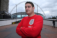 an England fan posing outside Wembley Stadium before k/o. FIFA World cup qualifying match, european group F, England v Malta at Wembley Stadium in London on Saturday 8th October 2016.<br /> pic by John Patrick Fletcher, Andrew Orchard sports photography.