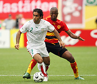 Photo: Chris Ratcliffe.<br /> <br /> Iran v Angola. FIFA World Cup 2006. 21/06/2006.<br /> <br /> Miloy of Angola clashes with Mehdi Mahdavikia of Iran.