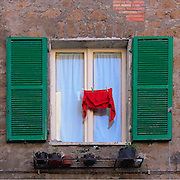 Red pullover and window, Orvieto, Italy