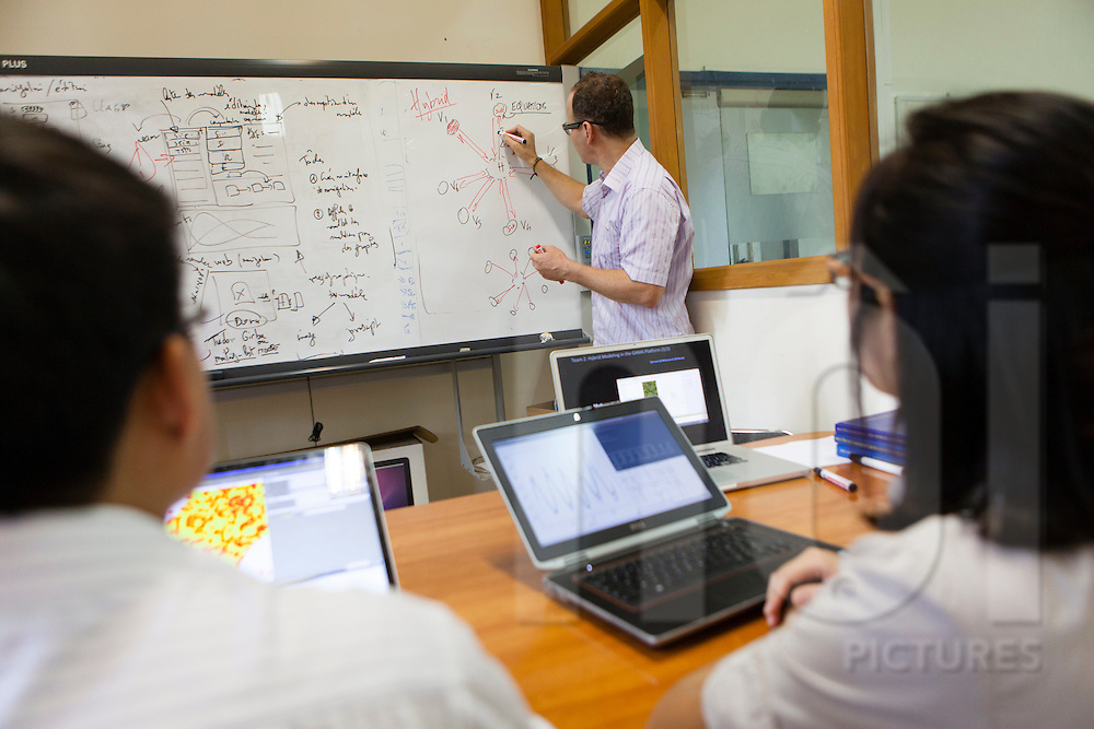 A lecturer draws formulas on a white board, Hanoi, Vietnam, Southeast Asia
