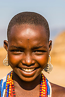 Young teenaged girl, Arbore tribe village, Omo Valley, Ethiopia.