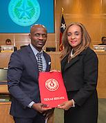 Houston ISD Board of Trustees president Rhonda Skillern-Jones, right, accepts a School Board Appreciation citation from Sylvia Garcia's office, January 15, 2015.