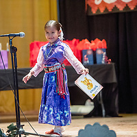 """Kindergarten-student Kamri Mae Hubbell finishes reading a passage from her favorite book """"Biscuit"""" during the 2018 Saint Michael Indian School Princess Pageant in St. Michael Thursday."""