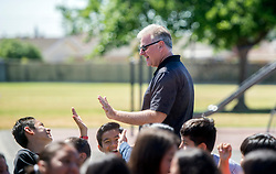 May 2, 2017 - Westminster, California, USA - Carlos Primiani high-fives students as he is surprised with a 2018 Teacher of the Year award in Westminster, California, on Tuesday, May 2, 2017. ..Primiani, a 6th grade teacher at Leo Carrillo Elementary School, is one of six teachers who were surprised with the honor by county superintendent of school Dr. Al Mija?res. ..(Photo by Jeff Gritchen, Orange County Register/SCNG) (Credit Image: © Jeff Gritchen, Jeff Gritchen/The Orange County Register via ZUMA Wire)