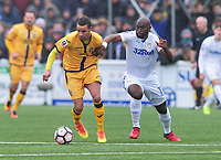 Football - 2016 / 2017 FA Cup - Fourth Round: Sutton United vs. Leeds United<br /> <br /> Craig Eastmond of Sutton and Souleyman Doukara of Leeds at Gander Green Lane.<br /> <br /> COLORSPORT/ANDREW COWIE