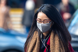 © Licensed to London News Pictures. 09/03/2020. Oxford, UK. A female commuter wears a grey face mask as she leaves Oxford train station as the COVID-19 coronavirus continues to spread across the United Kingdom. Photo credit: Peter Manning/LNP