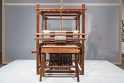 © Licensed to London News Pictures. 09/10/2018. LONDON, UK. A staff member views a 12 Shaft Counter March Loom, 1950s, similar to one used by Anni Albers and fellow students at the Bauhaus weaving workshop. Preview of the UK's first exhibition of works by German artist Anni Albers at Tate Modern who used the ancient art of hand-weaving to produce works of modern art.  Over 350 of her artworks from major collections from Europe and the US are on show 11 October to 27 January 2019.  Photo credit: Stephen Chung/LNP