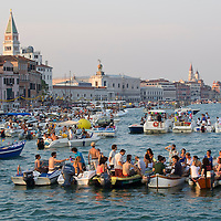 VENICE, ITALY - JULY 20: People gather on boats of all sizes at Punta della Dogana in St Mark's basin for the Redentore Celebrations on July 20, 2013 in Venice, Italy. Redentore is one of the most loved celebrations by Venetians which is in remembrance for the end of the 1577 plague. Highlights of the celebration include the pontoon bridge extending across the Giudecca Canal, gatherings on boats in the St Mark's basin and a spectacular fireworks display. (Photo by Marco Secchi/Getty Images)