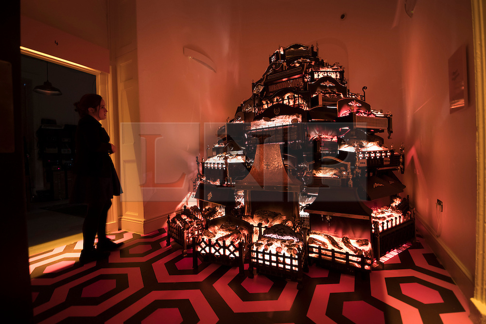 © Licensed to London News Pictures. PYRE by Stuart Haygarth, a glowing tower of electric fires, is seen at the exhibition Daydreaming with Stanley Kubrick in partnership with Canon at Somerset House in London. The show opens on July 6, 2016 and runs until August 24, 2016.  The exhibition features 50 works inspired by the legendary film director from a host of contemporary artists, musicians and filmmakers. London, UK.   Photo credit: Peter Macdiarmid/LNP