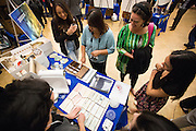 Attendees talk with graphic design students about the 3-D museum exhibition and other projects during Humanities & Arts Day Student Showcase at San Jose State University's Student Union Barrett Ballroom in San Jose, California, on October 25, 2013. (Stan Olszewski/SOSKIphoto)