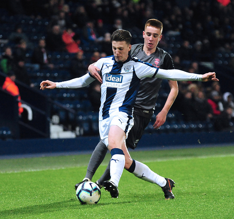 West Bromwich Albion U18's George Harmon shields the ball from  Lincoln City U18's Tobias Liversidge<br /> <br /> Photographer Andrew Vaughan/CameraSport<br /> <br /> FA Youth Cup Round Three - West Bromwich Albion U18 v Lincoln City U18 - Tuesday 11th December 2018 - The Hawthorns - West Bromwich<br />  <br /> World Copyright © 2018 CameraSport. All rights reserved. 43 Linden Ave. Countesthorpe. Leicester. England. LE8 5PG - Tel: +44 (0) 116 277 4147 - admin@camerasport.com - www.camerasport.com