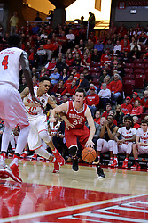"11 February 2017:  Daouda ""David"" Ndiaye (4) and Phil Fayne(10) work to contain Jayden Hodgson during a College MVC (Missouri Valley conference) mens basketball game between the Bradley Braves and Illinois State Redbirds in  Redbird Arena, Normal IL"