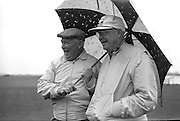 General Dwight D. Eisenhower plays golf in the rain with Joe Carr, the Irish Walker Cup Player, Mr. M. McCluskey, the United States Ambassador to Ireland, and Mr. Freeman Godsen, a member of the Generals Party, at Portmarnock Golf Club..23.08.1962.<br /> images of Dwight D. Eisenhower in Dublin, Ireland.<br /> ireland of Dwight D. Eisenhower in Dublin, Ireland.<br /> ireland pictures of Dwight D. Eisenhower in Dublin, Ireland.<br /> irish historic images of Dwight D. Eisenhower in Dublin, Ireland.<br /> irish historic photo of Dwight D. Eisenhower in Dublin, Ireland.<br /> irish historic photographs of Dwight D. Eisenhower in Dublin, Ireland.<br /> irish historic photos of Dwight D. Eisenhower in Dublin, Ireland.<br /> irish historic pictures of Dwight D. Eisenhower in Dublin, Ireland.<br /> irish historic pix of Dwight D. Eisenhower in Dublin, Ireland.<br /> irish historical images of Dwight D. Eisenhower in Dublin, Ireland.<br /> irish historical picture of Dwight D. Eisenhower in Dublin, Ireland.<br /> irish historical pictures of Dwight D. Eisenhower in Dublin, Ireland.<br /> irish history of Dwight D. Eisenhower in Dublin, Ireland. <br /> irish history photo of Dwight D. Eisenhower in Dublin, Ireland.<br /> irish history photos of Dwight D. Eisenhower in Dublin, Ireland.<br /> irish history pictures of Dwight D. Eisenhower in Dublin, Ireland.<br /> irish image of Dwight D. Eisenhower in Dublin, Ireland.<br /> irish images of Dwight D. Eisenhower in Dublin, Ireland.<br /> irish vintage image of Dwight D. Eisenhower in Dublin, Ireland.<br /> irish vintage photographs of Dwight D. Eisenhower in Dublin, Ireland.