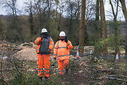 HS2 contractors use mobile phones to film a press photographer from a site alongside the A413 where trees have recently been felled for the HS2 high-speed rail link on 9th April 2021 in Wendover, United Kingdom. Tree felling work for the project is now taking place at several locations between Great Missenden and Wendover in the Chilterns AONB, including at Jones Hill Wood.