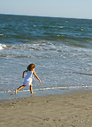 Child runs on beach Family, Family activities Children, Camping young adults