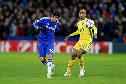 Diego Costa of Chelsea is challenged by Joao Mario of Sporting - Photo mandatory by-line: Rogan Thomson/JMP - 07966 386802 - 10/12/2014 - SPORT - FOOTBALL - London, England - Stamford Bridge - Sporting Clube de Portugal - UEFA Champions League Group G.