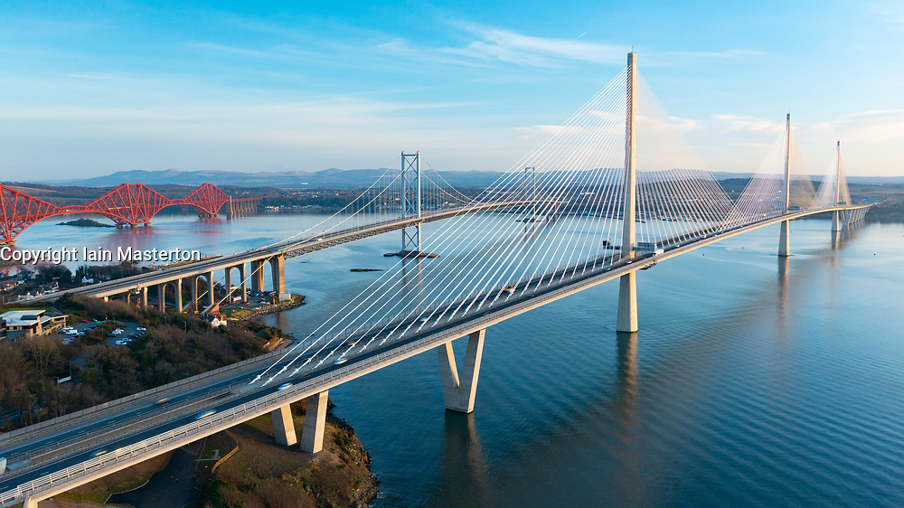 Aerial view of three major bridges crossing River Forth at North Queensferry, closest is Queensferry Crossing Bridge, Scotland UK