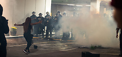 September 21, 2016 - Charlotte, North Carolina, United States of America - Sept. 21, 2016 - Charlotte, UNITED North CarolinaS - , Protestors confront police at the Omni Hotel during a protest and eventual riot in Uptown Charlotte, North Carolina, The United States, Wednesday 21 September 2016. This is the second day of violence that erupted after a police officer's fatal shooting of an African-American man Tuesday afternoon. (Credit Image: © Sean Meyers via ZUMA Wire)