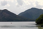 A boat crosses the Middle Lake or Muckross Lake in killarney County Kerry..Picture by Don MacMonagle