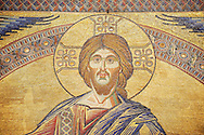 The Medieval mosaics of the ceiling of The Baptistry of Florence Duomo ( Battistero di San Giovanni ) showing Jesus Christ ,  started in 1225 by Venetian craftsmen in a Byzantine style and completed in the 14th century. Florence Italy
