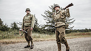 USA, Oregon, Astoria, Ft. Stevens State Park, living historian infantry soldiers resting.