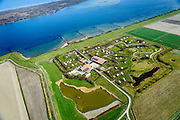 Nederland, Zeeland, Gemeente Schouwen-Duiveland, 01-04-2016; <br /> Landschapscamping Kijkuit aan de oevers van het Grevelingenmeer, het grootste zoutwatermeer van West-Europa.<br /> Caravan camping at border of Grevelingen (or Grevelingenmeer)<br /> the largest saltwater lake in Western Europe.<br /> <br /> luchtfoto (toeslag op standard tarieven);<br /> aerial photo (additional fee required);<br /> copyright foto/photo Siebe Swart